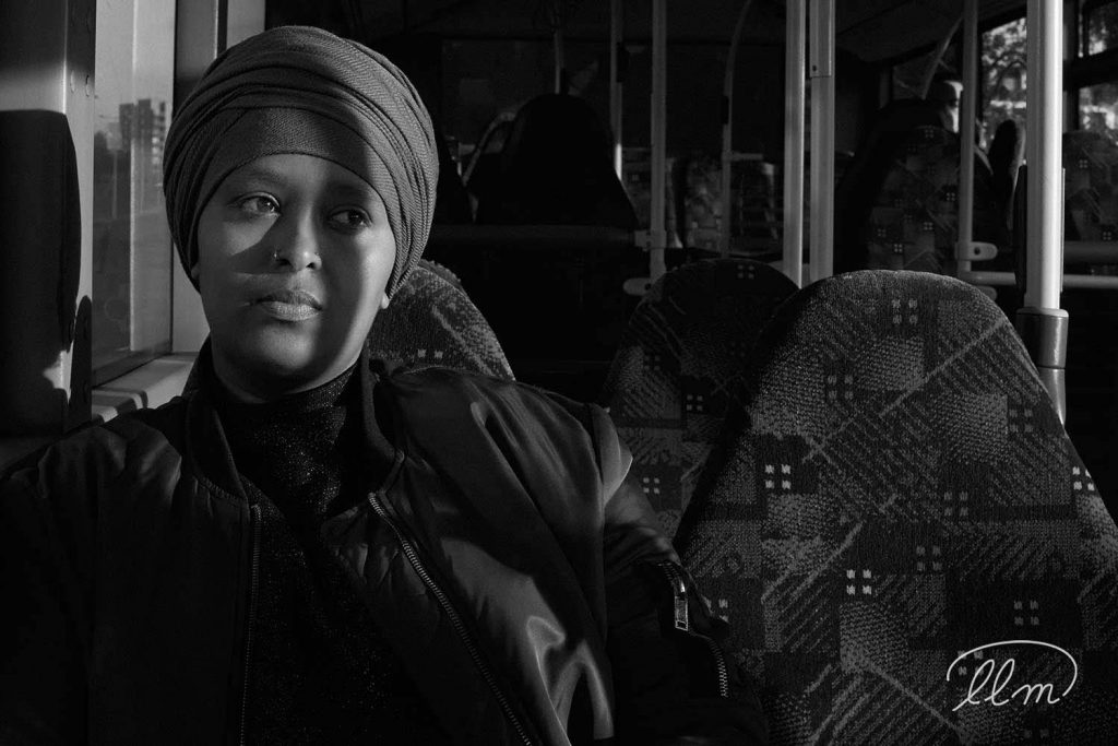 Somali trader Amiira Ismail of Basbass Sauce, Lady Lane Market, on the bus to the food market