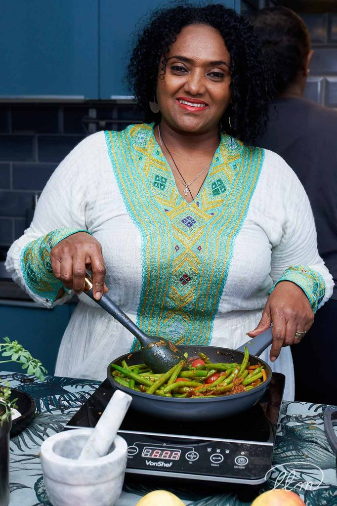 Lady Lane Market trader Woin Tegegn at home cooking for Ethiopic Kitchen - cooking