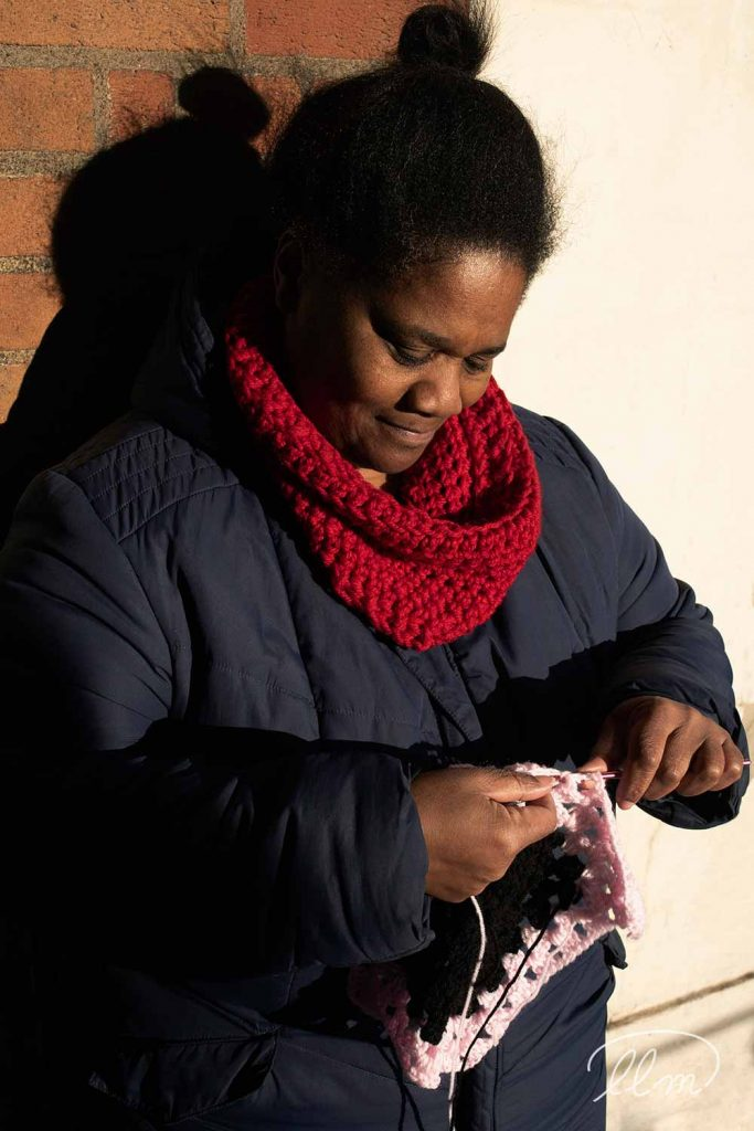 Audrey Aymer founder of East London Stitched, knitted goods, crocheting while standing
