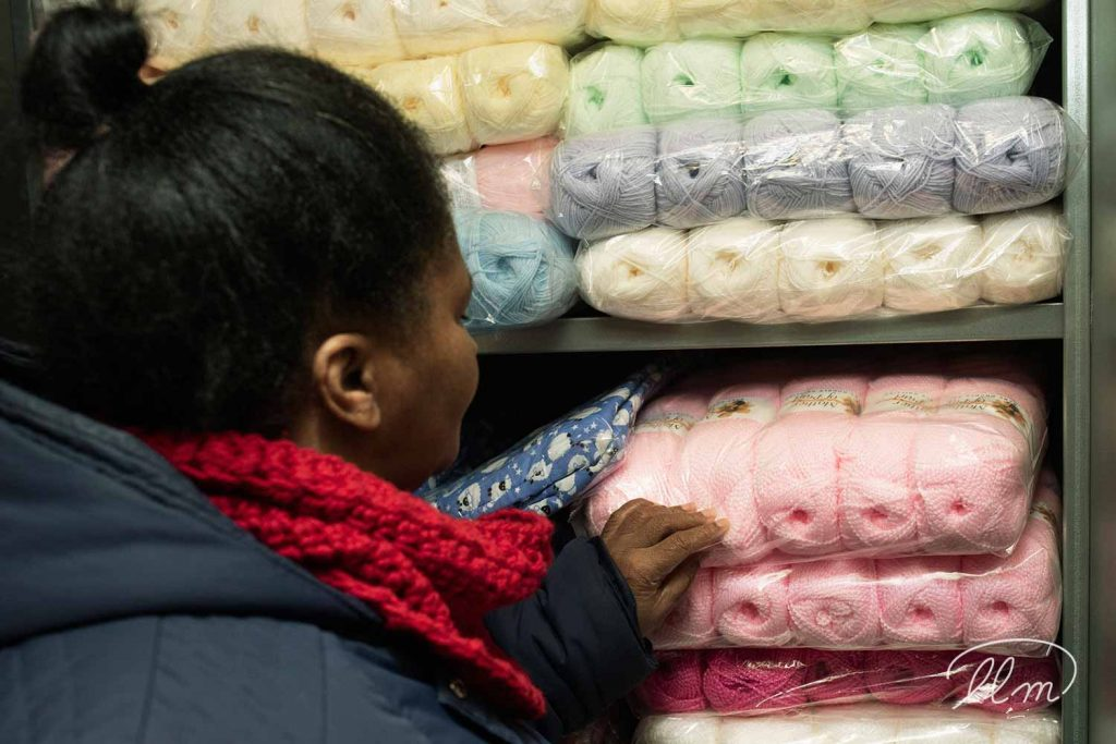 Audrey Aymer founder of East London Stitched, knitted goods, choosing wall