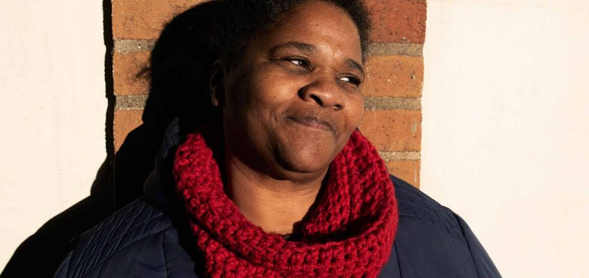 Audrey Aymer founder of East London Stitched, knitted goods, profile shot against brick wall