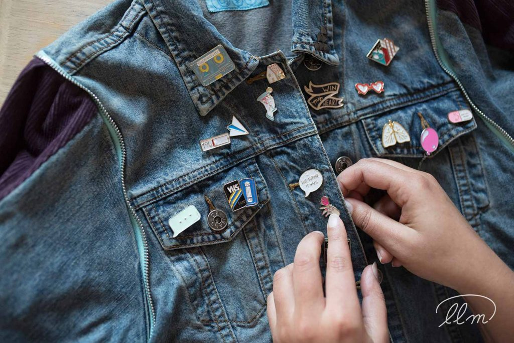 Anila Babla founder of Lubjoo accessorising a denim jacket with enamel pins