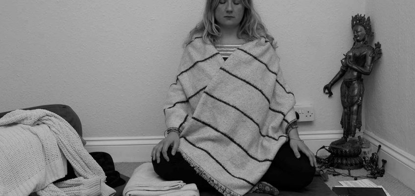 Buddhist founder of The Wild Orchard Fabric Company, Lottie Lee-Gough meditating